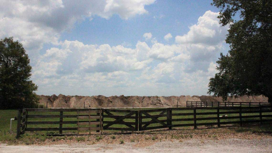 Earth is heaped behind the fence on the SMR Farms building, part of Lakewood Ranch's Northeast Quadrant