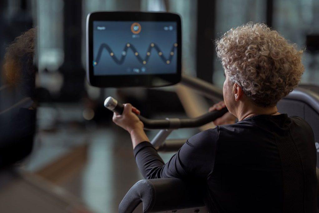 older lady on indoor bike